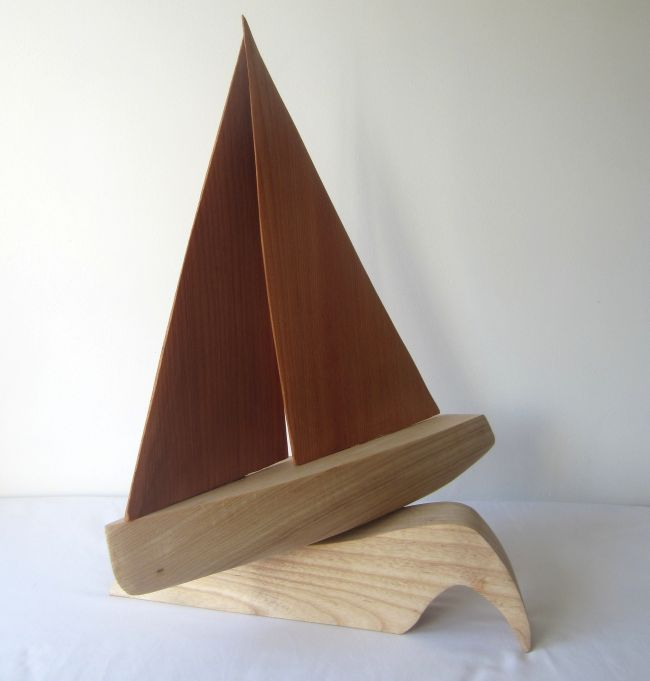 Hand carved ornamental sailing boat in pine and ash
